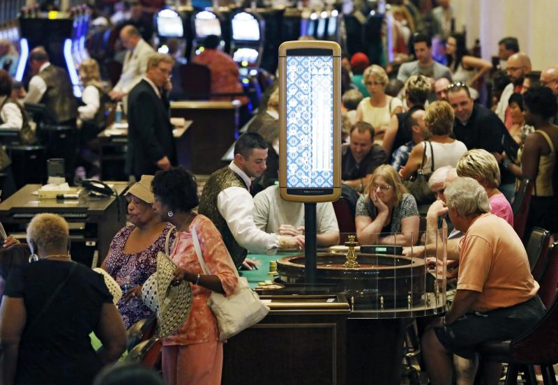 In this June 29, 2012 file photo, patrons gamble on the main gaming floor at the Horseshoe Casino in Cleveland. An industry report released Wednesday, March 26, 2014 said 2012 revenue growth by commercial casinos, such as Horseshoe Casino, outpaced that by Indian-owned casinos for the first time in nearly 20 years. (AP Photo/Mark Duncan, File)