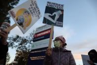 People attend a protest for nurses demanding more PPE, coronavirus testing, and staff, as the outbreak of the coronavirus disease (COVID-19) continues, in West Hills, Los Angeles