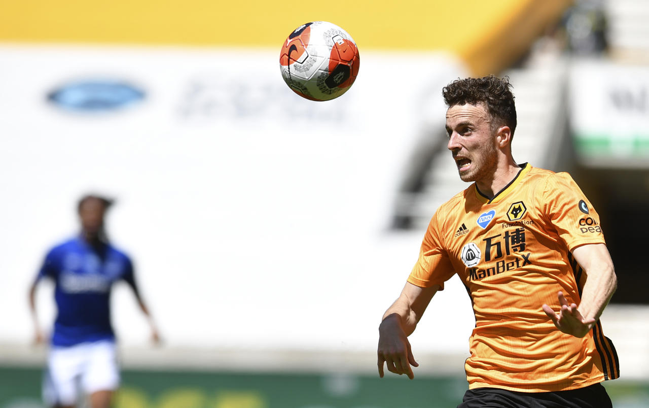Wolverhampton Wanderers' Diogo Jota controls the ball during the English Premier League soccer match between Watford and Everton at the Molineux Stadium in Wolverhampton, England, Sunday, July 12, 2020. (Ben Stansall/Pool via AP)