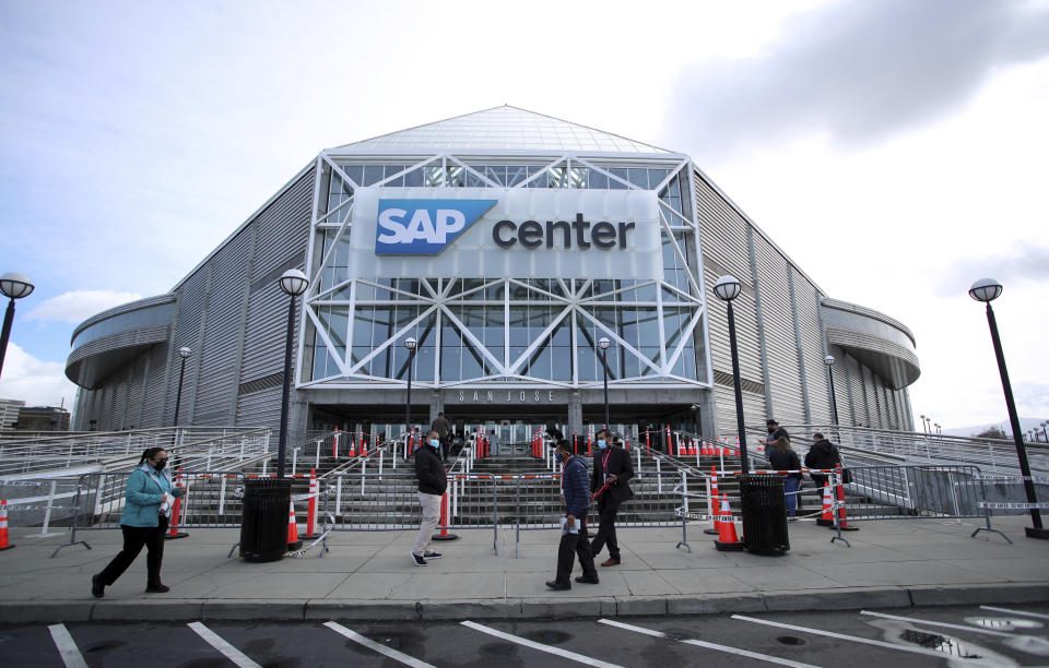 Staff arrive for COVID-19 testing before entering SAP Center for an NHL hockey game between the Vegas Golden Knights and the San Jose Sharks in San Jose, Calif., Saturday, Feb. 13, 2021. (AP Photo/Josie Lepe)