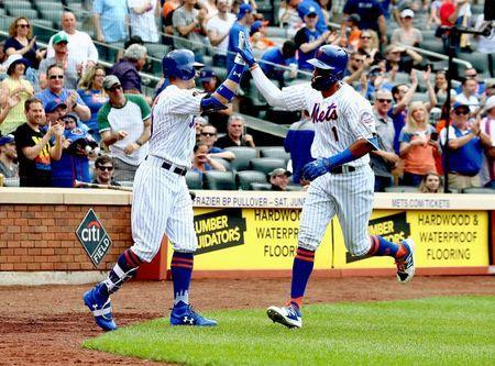 May 20, 2018; New York City, NY, USA; New York Mets shortstop Amed Rosario (1) is congratulated by left fielder Brandon Nimmo (9) after hitting a solo home run against the Arizona Diamondbacks during the sixth inning USA TODAY Sports