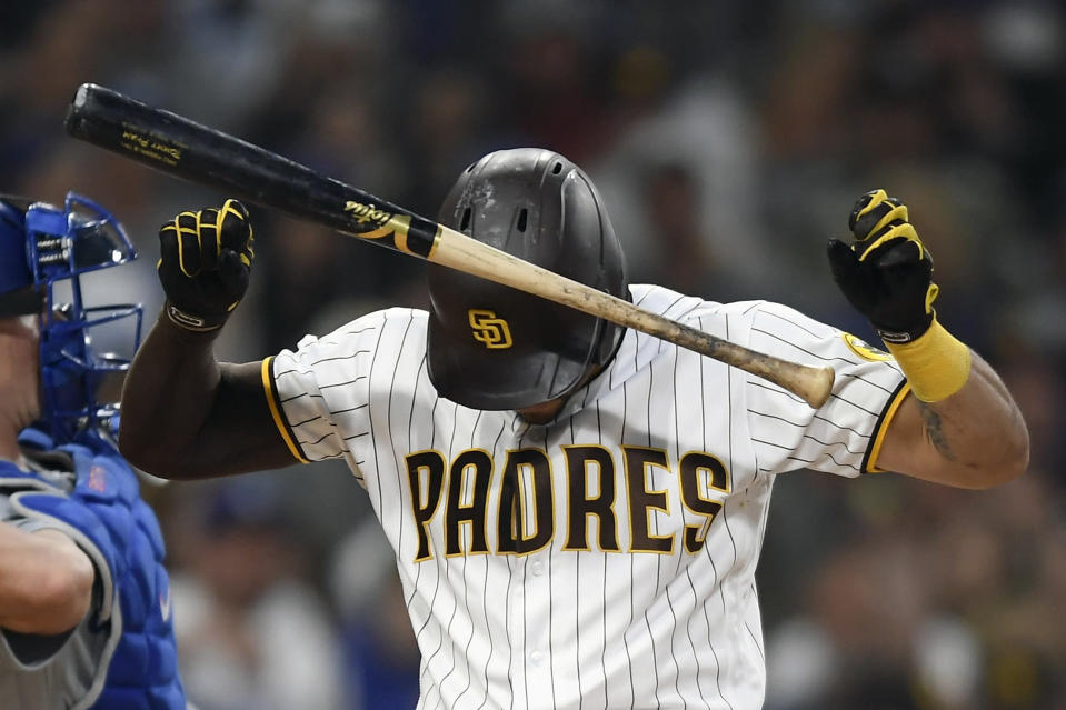 San Diego Padres' Tommy Pham (28) slams his bat into his helmet after striking out during the third inning of a baseball game against Los Angeles Dodgers Tuesday, June 22, 2021, in San Diego. (AP Photo/Denis Poroy)