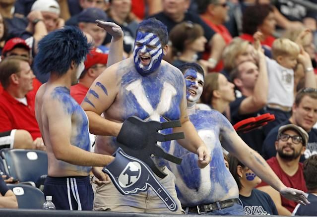 BYU fans celebrate during the second half of an NCAA college football game against Houston, Saturday, Oct. 19, 2013 in Houston. BYU defeated Houston, 47-46. (AP Photo/Eric Christian Smith)