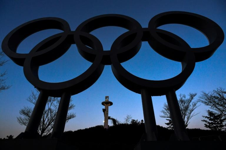 The ski jump tower is seen behind the the Olympic rings ahead of the Pyeongchang 2018 Winter Olympic Games in Pyeongchang