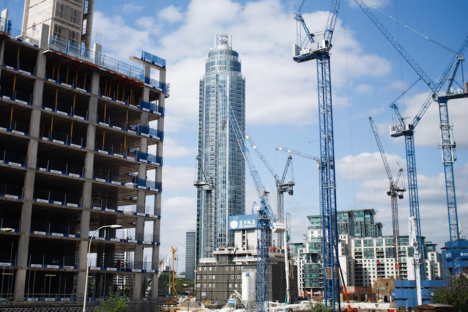 Cranes work on a construction site near to the 50-storey St George Wharf Tower in the Vauxhall area of London, England, on July 15, 2019. Research by the New London Architecture forum released earlier this year revealed that 76 tall buildings (defined as those over 20 storeys high) are projected to be completed in the capital over the course of 2019, just two years on from the devastating fire at residential high-rise Grenfell Tower in North Kensington. The figure represents a three-fold increase over the number of completions in 2018, with the NLA's 2019 'London Tall Buildings Survey' estimating that those towers under construction may altogether provide more than 110,000 new homes across the city.  (Photo by David Cliff/NurPhoto via Getty Images)