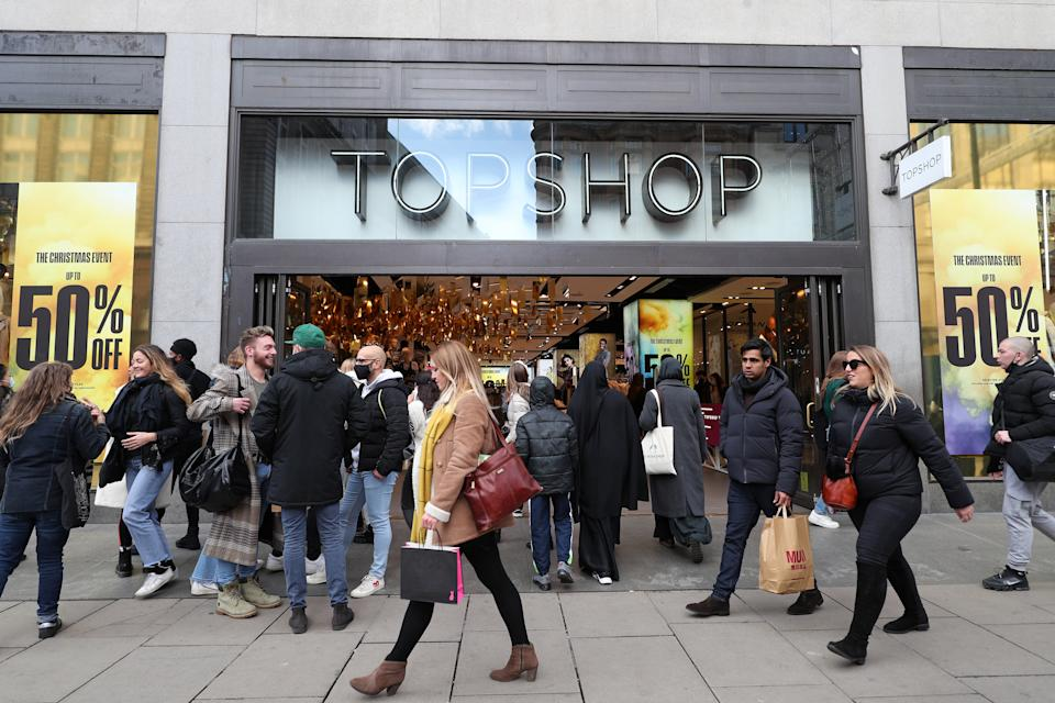 Shoppers outside Topshop on Oxford Street in London on the first weekend following the end of the second national lockdown in England, with coronavirus restrictions being relaxed. (Photo by Yui Mok/PA Images via Getty Images)