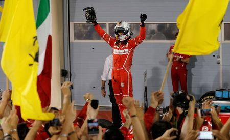 Formula One - F1 - Bahrain Grand Prix - Sakhir, Bahrain - 16/04/17 - Ferrari Formula One driver Sebastian Vettel of Germany celebrates after winning Bahrain Grand Prix. REUTERS/Hamad I Mohammed
