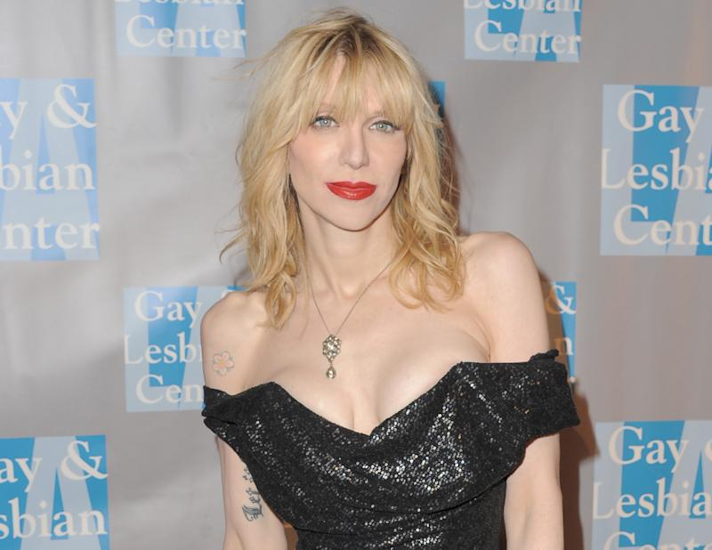 "FILE - In this May 19, 2012 file photo, musician Courtney Love attends ""An Evening With Women,"" in Los Angeles. Love's former assistant sued the Hole front-woman on Tuesday, July 10, 2012 in Los Angeles, claiming the rocker owes her unpaid wages and asked her to perform unethical duties such as hiring a hacker and forge legal correspondence.  (Photo by Jordan Strauss/Invision, File)"