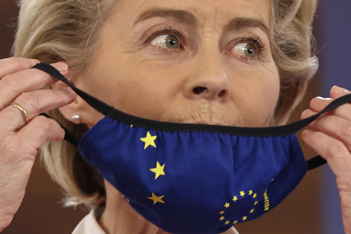 European Commission President Ursula von der Leyen puts on her protective face mask during a media conference at an EU summit in Porto, Portugal, Saturday, May 8, 2021. On Saturday, EU leaders held an online summit with India's Prime Minister Narendra Modi, covering trade, climate change and help with India's COVID-19 surge. (AP Photo/Luis Vieira)