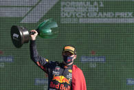 Red Bull driver Max Verstappen of the Netherlands celebrates on the podium after winning the Formula One Dutch Grand Prix, at the Zandvoort racetrack, Netherlands, Sunday, Sept. 5, 2021. (AP Photo/Peter Dejong)