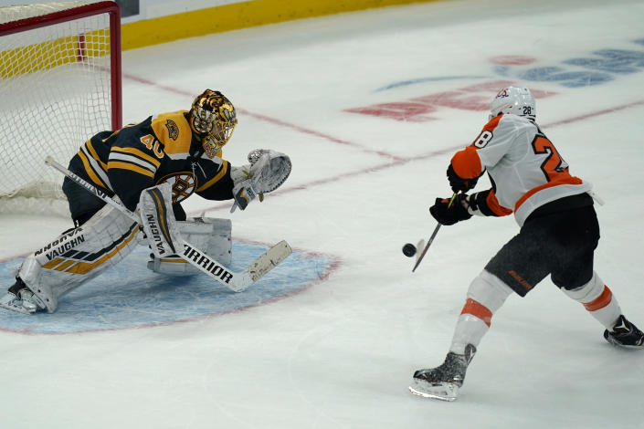 Boston Bruins goaltender Tuukka Rask (40) makes the save on this attempt by Philadelphia Flyers center Claude Giroux (28) during a shootout in an NHL hockey game, Thursday, Jan. 21, 2021, in Boston. The Bruins won 5-4 in a shootout. (AP Photo/Elise Amendola)