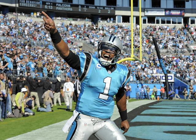 Carolina Panthers quarterback Cam Newton (1) celebrates after his team's touchdown against the Atlanta Falcons in the first half of an NFL football game in Charlotte, N.C., Sunday, Nov. 3, 2013. (AP Photo/Mike McCarn)
