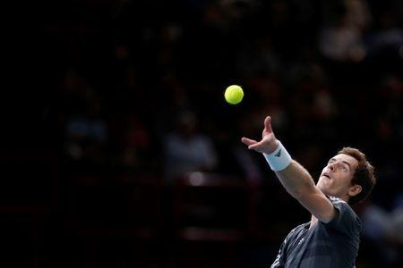 Andy Murray of Britain serves the ball during his men's singles tennis match against Grigor Dimitrov of Bulgaria in the third round of the Paris Masters tennis tournament at the Bercy sports hall in Paris, October 30, 2014. REUTERS/Benoit Tessier