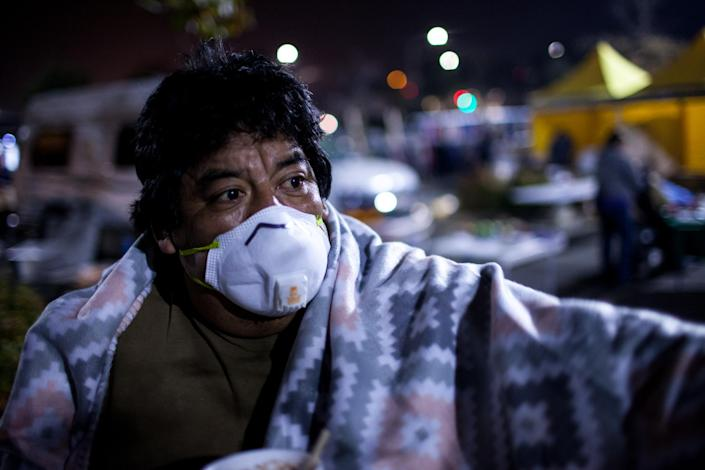 <p>Luis Badres, 51, who was evacuated from his home due to the Camp Fire, is living out of a tent with his family at a Walmart parking lot in Chico, Calif., on Nov. 13, 2018 (Photo: Joel Angel Juarez/ZUMA Wire) </p>