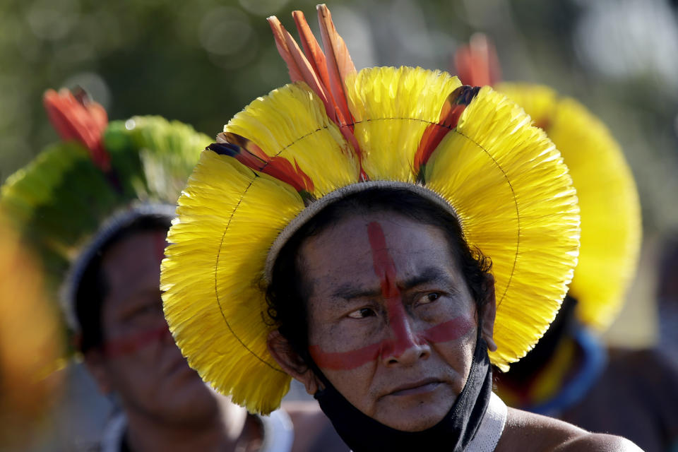 An Indigenous Kayapo man attends a protest against Brazilian President Jair Bolsonaro's proposals to allow mining on Indigenous lands, at the entrance to the Chamber of Deputies in Brasilia, Brazil, Wednesday, June 16, 2021. (AP Photo/Eraldo Peres)
