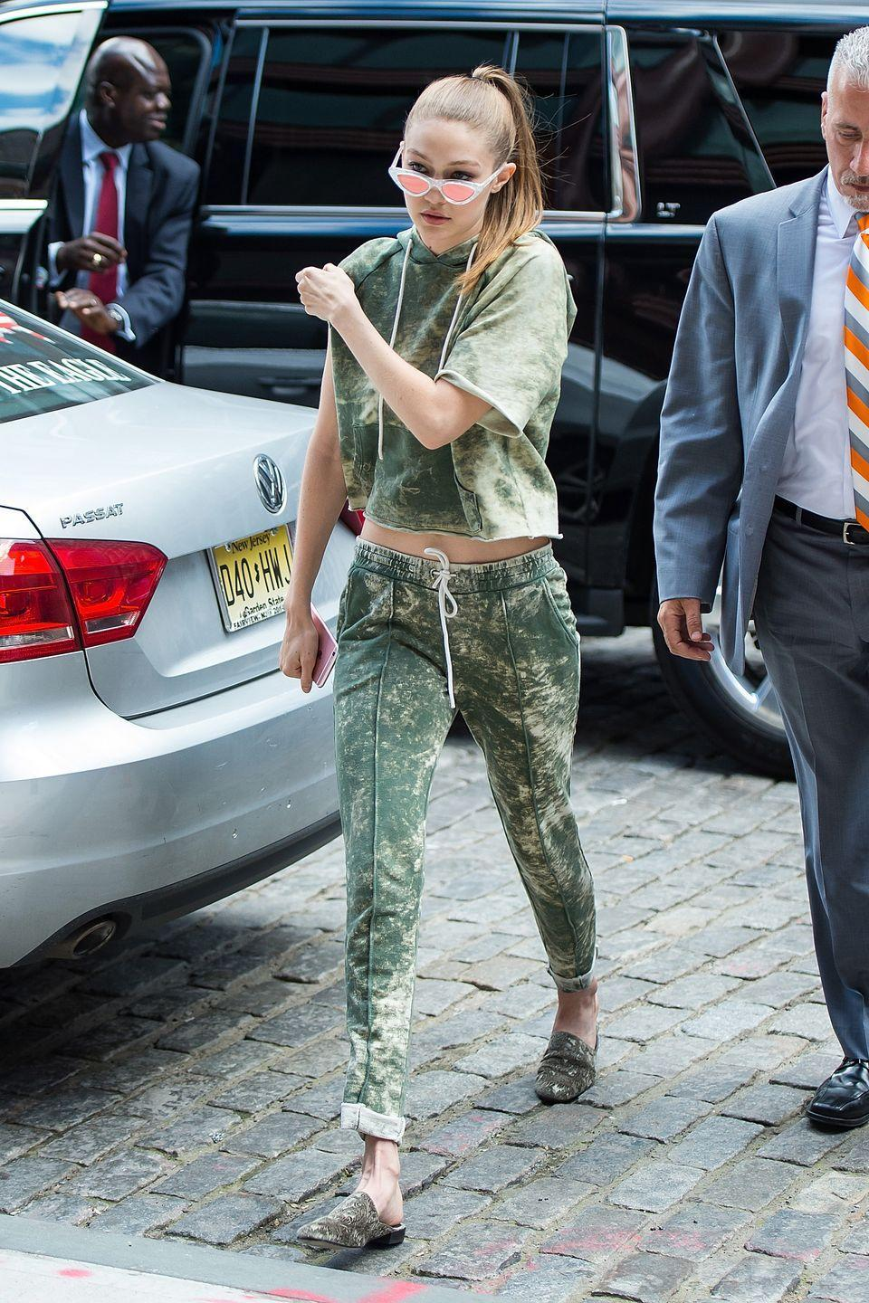 <p>In Cotton Citizen sweat pants and cutoff hoodie, printed Stuart Weitzman velvet flats and cat eye sunglasses while out in New York.</p>