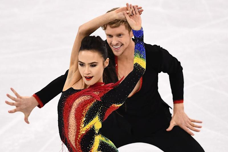 From left: ice dancers Madison Chock and Evans Bates competing in the short dance portion of their event at the 2018 Winter Olympics