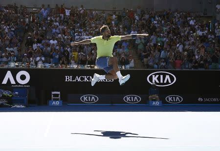 Tennis - Australian Open - Margaret Court Arena, Melbourne, Australia, January 17, 2018. Jo-Wilfried Tsonga of France celebrates winning against Denis Shapovalov of Canada. REUTERS/Edgar Su  TPX IMAGES OF THE DAY