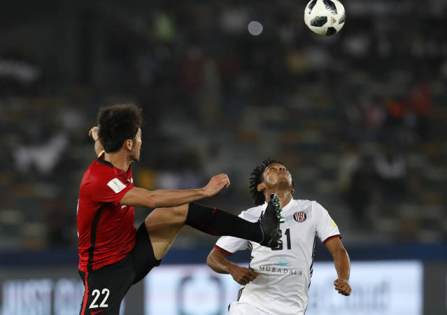 Japan's Urawa Reds Yuki Abe, left, challenges for the ball with Al Jazira's Romarinho during the Club World Cup soccer match between Al Jazira Club and Urawa Reds at Zayed sport city in Abu Dhabi, United Arab Emirates, Saturday, Dec. 9, 2017. (AP Photo/Hassan Ammar)