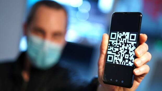 Quebecers now have the option of receiving a QR code as proof of their COVID-19 vaccination, and talks on a national vaccination passport for international travel are already underway in Ottawa.                               (Sylvain Roy Roussel/CBC - image credit)