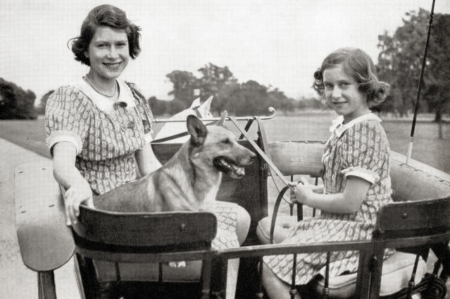 Princess Elizabeth, future Queen Elizabeth II, left, and Princess Margaret, right, driving a pony and trap in Great Windsor Park, England, 1941. Princess Margaret, Margaret Rose, 1930 – 2002, aka Princess Margaret Rose. Younger daughter of King George VI and Queen Elizabeth. Princess Elizabeth, future Elizabeth II, born 1926. Queen of the United Kingdom, Canada, Australia and New Zealand. From a photograph. (Photo by: Universal History Archive/Universal Images Group via Getty Images)