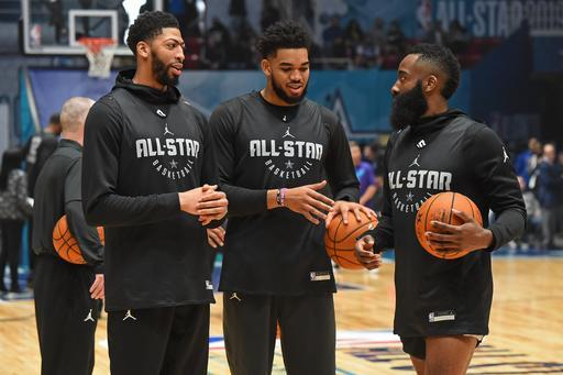 Anthony Davis (left) chats with Karl-Anthony Towns (middle) and James Harden during practice Saturday at Charlotte, North Carolina. (Photo by Andrew D. Bernstein/NBAE via Getty Images)