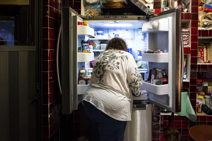 """<p>Antonia Casilla Guzman, 62, looks for food in her fridge to prepare a snack. Guzman suffers from obesity, and one of her daughters has had a gastric bypass operation to lose weight. Malnutrition and obesity are two sides of the same coin: While undernutrition undermines physical growth and impairs brain development, obesity can lead to non-communicable diseases such as type II diabetes, hypertension, and cancer. Experts expect that """"overnutrition"""" is expected to become the largest social and economic burden in the region. From 2014 to 2078, overweight and obesity are projected to cost on average $13 billion in Mexico per year. (Photograph by Silvia Landi) </p>"""