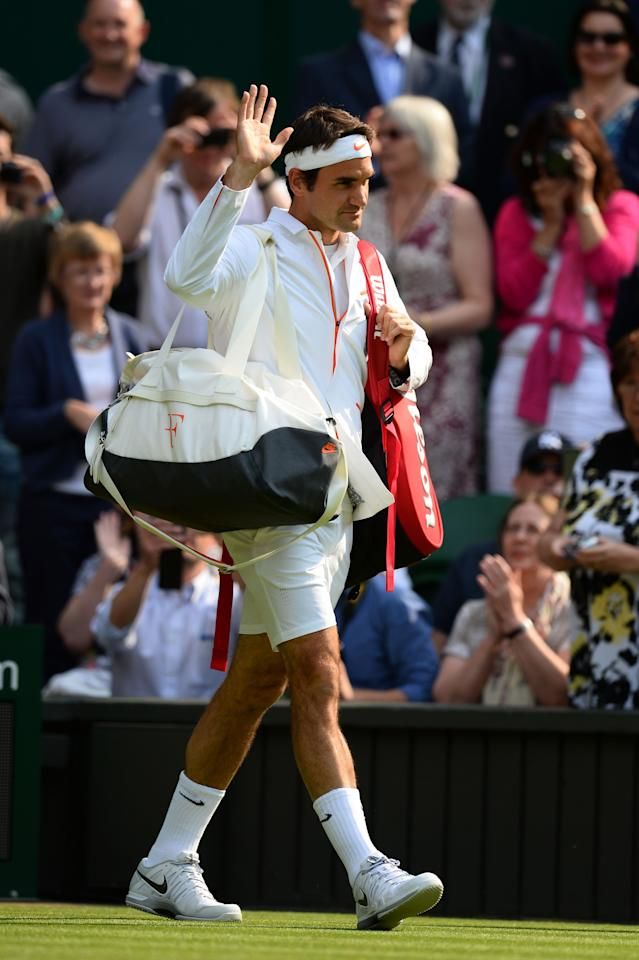 LONDON, ENGLAND - JUNE 26: Roger Federer of Switzerland waves to the crowd as he walks out on court for his Gentlemen's Singles second round match against Sergiy Stakhovsky of Ukraine on day three of the Wimbledon Lawn Tennis Championships at the All England Lawn Tennis and Croquet Club on June 26, 2013 in London, England. (Photo by Mike Hewitt/Getty Images)