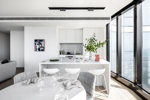 A marble kitchen within one of Australia 108's incredible apartments