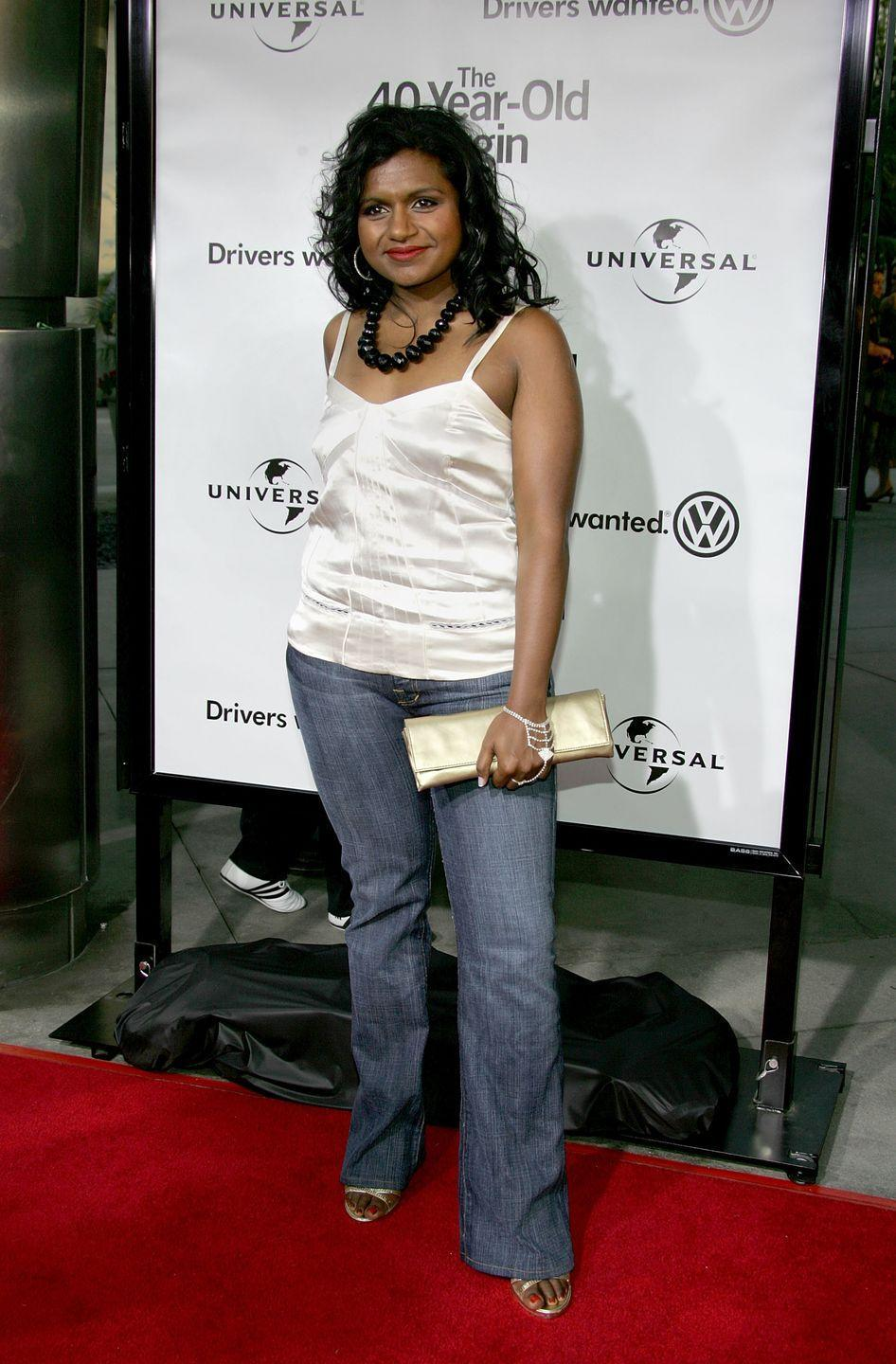 <p>Mindy gussied up in a satin top, wide-leg jeans, and an extra chunky necklace for the premiere of <em>The 40-Year-Old Virgin</em>.</p>