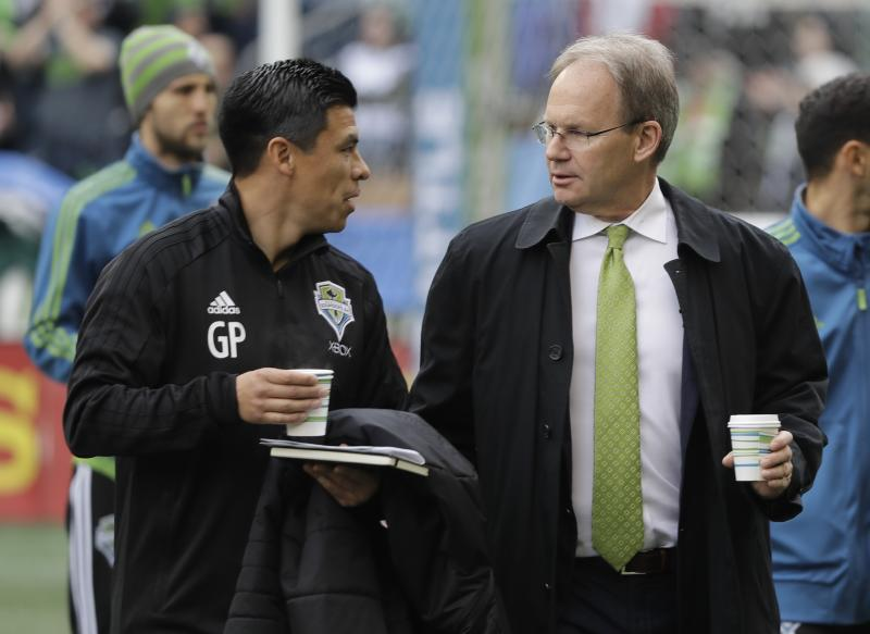 Seattle Sounders head coach Brian Schmetzer right, walks with assistant coach Gonzalo Pineda, left, before an MLS soccer match against Los Angeles, Sunday, March 4, 2018, in Seattle. (AP Photo/Ted S. Warren)