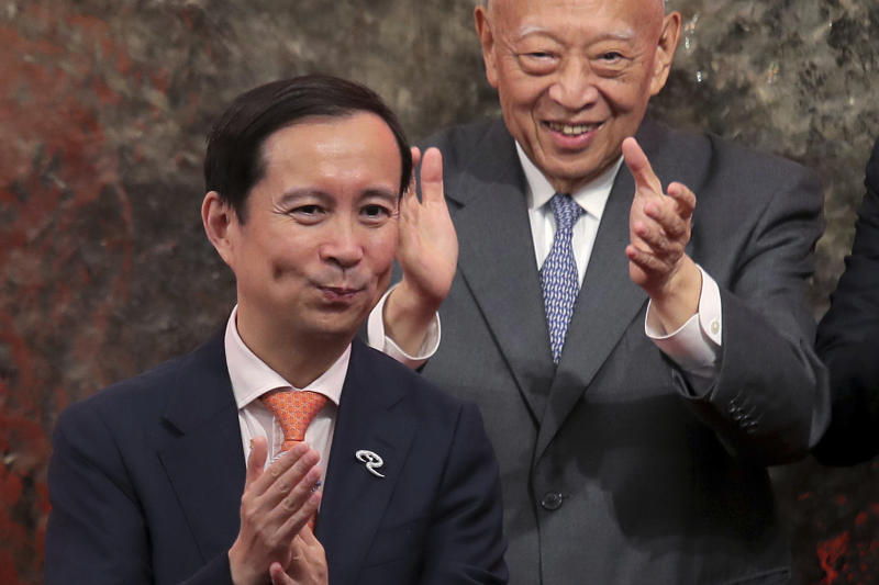 Chairman and CEO of Alibaba Group Daniel Zhang Yong, left, and Vice Chairman of the National Committee of the Chinese People's Political Consultative Conference Tung Chee-hwa attend the Alibaba Group's listing ceremony at the Hong Kong Stock Exchange (HKEX) in Hong Kong, Tuesday, Nov. 26, 2019. (AP Photo/Kin Cheung)