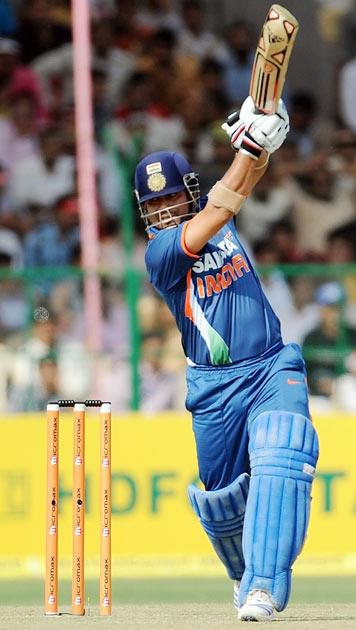 Indian cricketer Sachin Tendulkar plays a shot during the second one day international (ODI) cricket match between India and South Africa at The Captain Roop Singh Stadium in Gwalior on February 24, 2010.     India are currently 100 runs for the loss of one wicket in fifteen overs after winning the toss and electing to bat first.   AFP PHOTO/MANAN VATSYAYANA