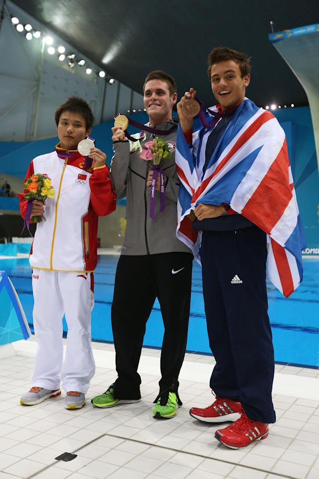 LONDON, ENGLAND - AUGUST 11: Silver medallist Bo Qui of China, gold medallist David Boudia of the United States, and bronze medallist Tom Daley of Great Britain pose after the medal ceremony for the Men's 10m Platform Diving Final on Day 15 of the London 2012 Olympic Games at the Aquatics Centre on August 11, 2012 in London, England. (Photo by Clive Rose/Getty Images)