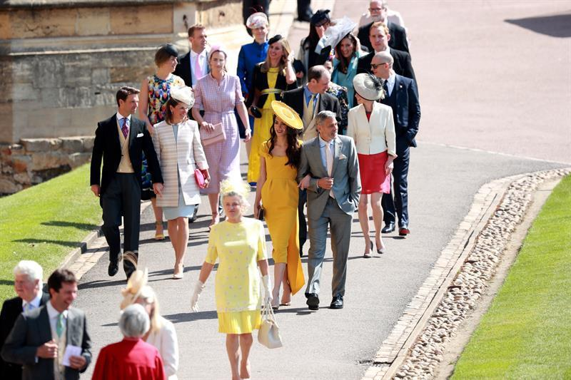 US actor George Clooney (R) and his wife British human rights barrister Amal Clooney (C-R) arrive for the royal wedding ceremony of Britain's Prince Harry and Meghan Markle at St George's Chapel in Windsor Castle, in Windsor, Britain (PA)