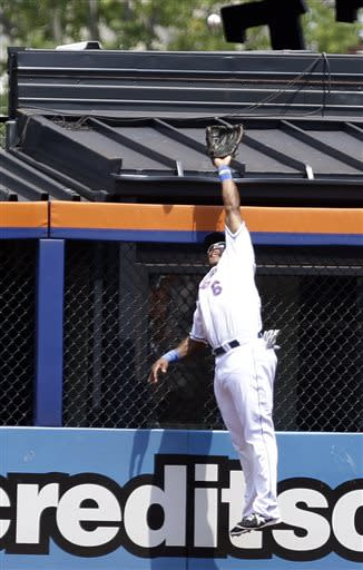 New York Mets right fielder Marlon Byrd is unable to a catch a ball hit by Philadelphia Phillies' Jimmy Rollins for a home run during the first inning of a baseball game Saturday, July 20, 2013, in New York. (AP Photo/Frank Franklin II)