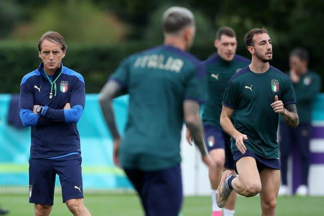 Italy manager Roberto Mancini (left) with his players during a training session at Tottenham Hotspur's training ground.