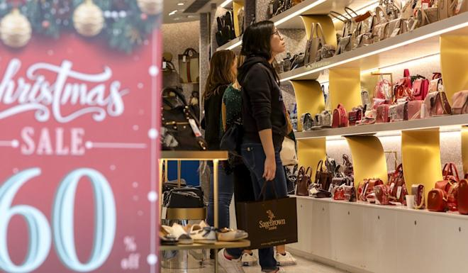 Shops are offering Christmas discounts but fewer are taking the bait. Photo: May Tse