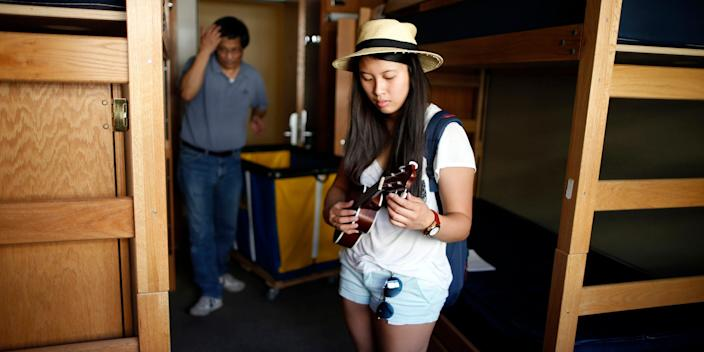 """A freshman attending the University of California, Los Angeles moves into her dorm, September 25, 2014. <p class=""""copyright"""">Lucy Nicholson/Reuters</p>"""