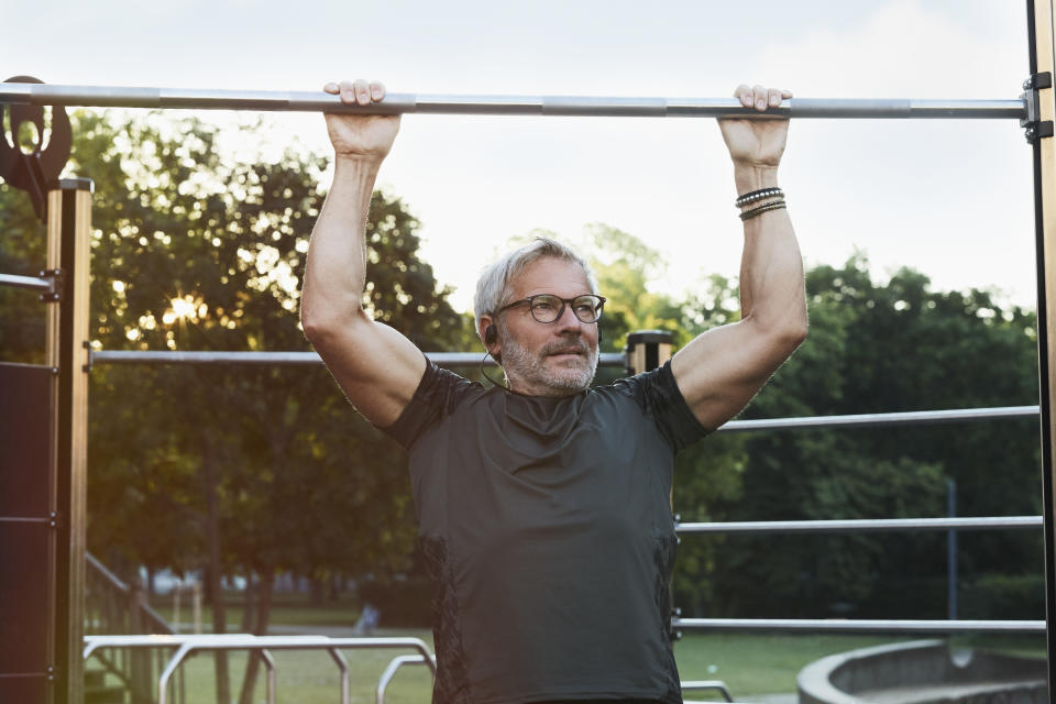 elderly handsome man exercising in an outdoor gym