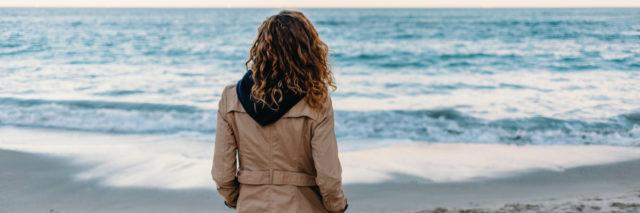 A woman looking at the ocean