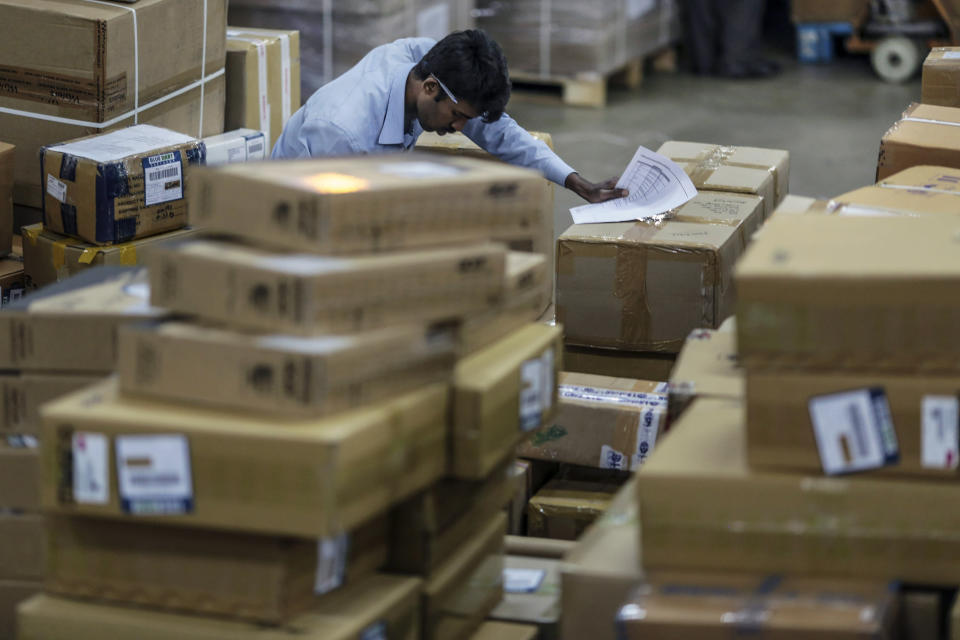 A Blue Dart Express Ltd. employee checks packages during the overnight sort at the company's joint hub with DHL Express India Pvt. in Cargo Terminal 3 at Bengaluru International Airport in Bengaluru, India, on Friday, Feb. 20, 2015. Blue Dart, a unit of DHL Express, is adding a Boeing Co. 757 freighter to its fleet of five in the South Asian country and building warehouses for sellers using portals such as Amazon.com Inc. and Flipkart.com, Malcolm Monteiro, chief executive officer of DHL eCommerce, said in an interview in Mumbai. Photographer: Dhiraj Singh/Bloomberg via Getty Images