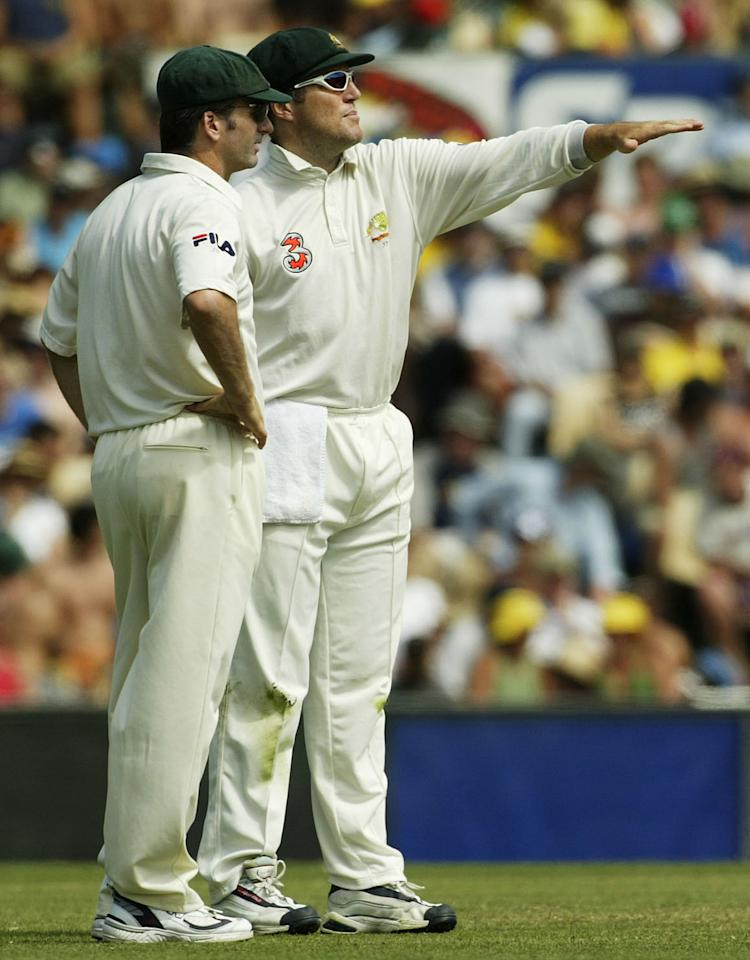 SYDNEY, AUSTRALIA - JANUARY 5:  Steve Waugh and Stuart MacGill of Australia talk tactics during day four of the 4th Test between Australia and India on January 5, 2004 at the SCG in Sydney, Australia.  (Photo by Hamish Blair/Getty Images)