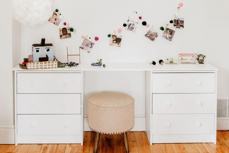 """<p>If you've struggled with how to make use of old furniture, this kid's space, designed by Sara Johnston, will inspire you. """"We painted two old IKEA dressers with leftover white paint and asked a local lumber provider for the top, which just happened to be shelving cut down to this specific size,"""" she says.</p>"""