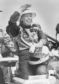 Janet Guthrie celebrates after becoming the first woman to ever qualify for the Indianapolis 500. Photo: Getty Images.