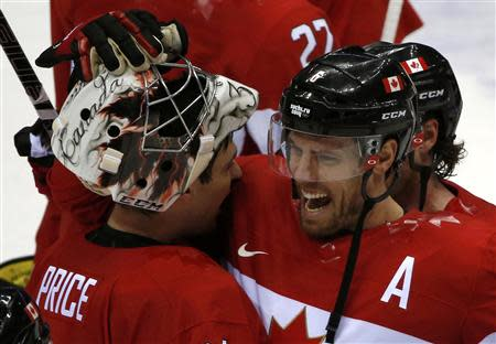 Canada's Weber celebrates with goalie Price after Canada won their men's ice hockey semi-final game against Team USA at the 2014 Sochi Winter Olympic Games