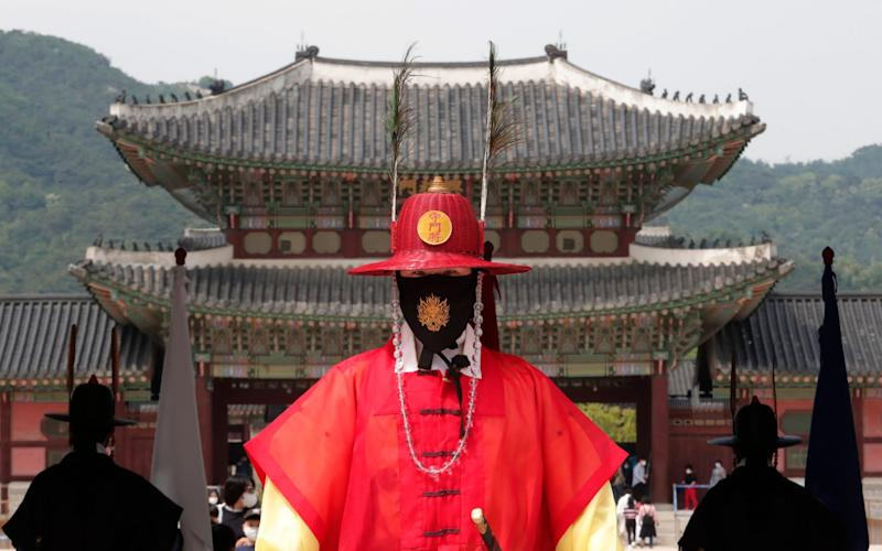South Korea has expressed gratitude to foreign war veterans by sending masks - Ahn Young-joon/AP