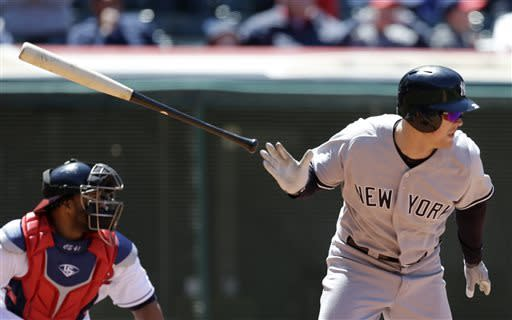 New York Yankees' Brennan Boesch hits a single off Cleveland Indians starting pitcher Justin Masterson in the ninth inning in the first baseball game of a doubleheader, Monday, May 13, 2013, in Cleveland. Carlos Santana watches. The Indians won 1-0. (AP Photo/Tony Dejak)