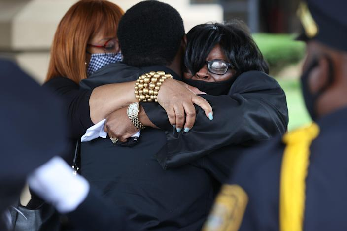 Widow Cathy Beck is consoled by family and friends during her husband Ivory Beck Sr.'s funeral services at New Life of Memphis church on Saturday, May 29, 2021.