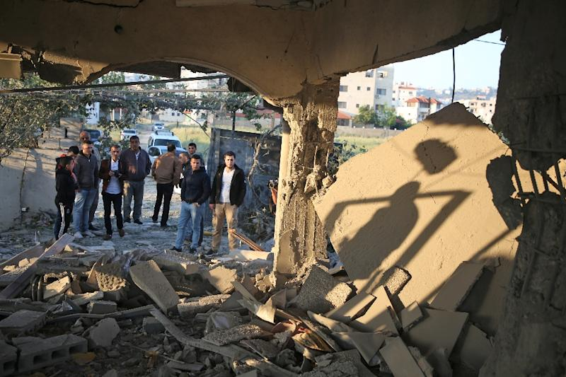 Palestinians inspect the West Bank house of a man suspected of the January 2018 murder of an Israeli rabbi, after it was demolished by Israeli forces on April 24, 2018